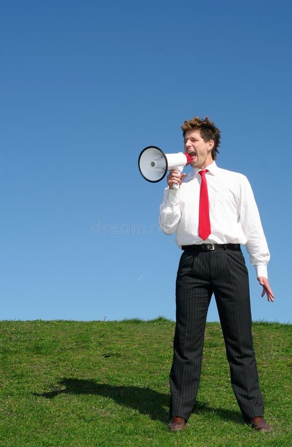 megaphone επιχειρηματιών χρησιμοποίηση στοκ εικόνα