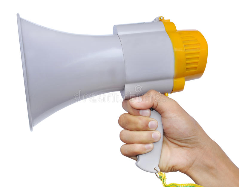 Megaphone. Holding a white megaphone. Isolated on a white background stock photography