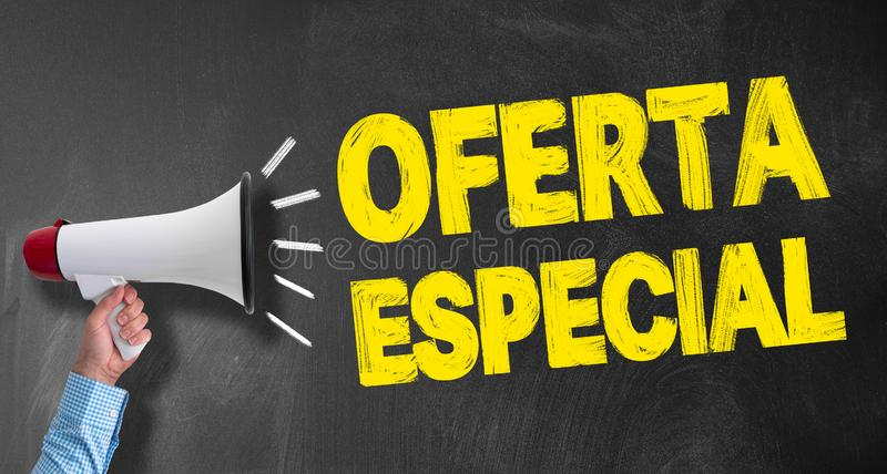Megaphone or bullhorn against blackboard with text OFERTA ESPECIAL, Spanish for SPECIAL OFFER. Hand of businessman holding megaphone or bullhorn against royalty free stock photography