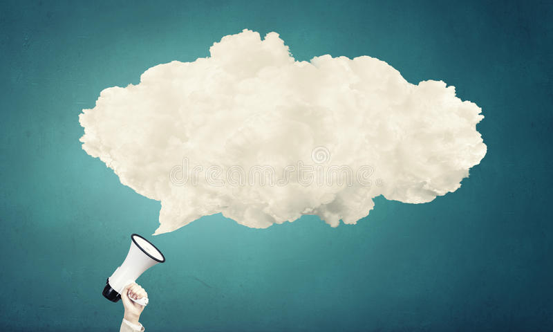 Megaphone in hand. Hand holding megaphone and white speech blank cloud royalty free stock images