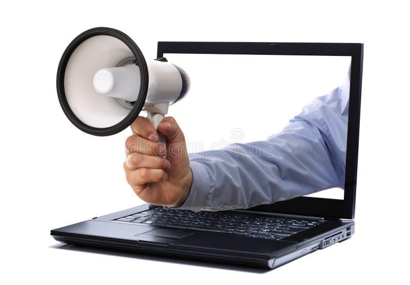 Megaphone through laptop monitor. Megaphone through a laptop computer monitor royalty free stock image