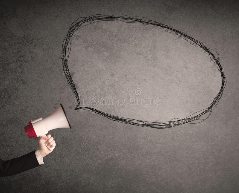 Megaphone with talk bubble. Caucasian business hand holding megaphone with drawn empty speech bubble royalty free stock photo