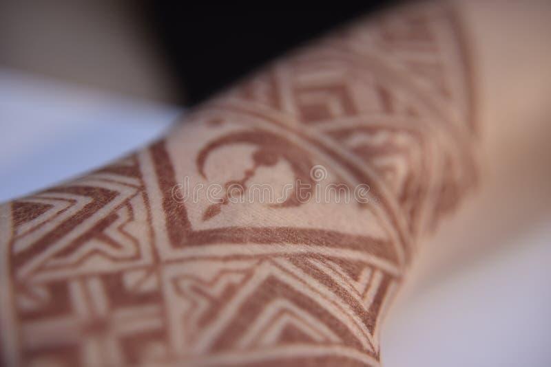 Mehendi pattern on hand. Brown mehendi pattern on hand culture iranian islamic moon henna art geometric indian hindi traditional close-up temporary tattoo stock photos