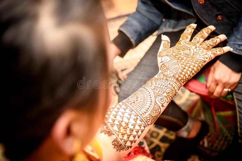 Mehendi Rasm. Hands at the time of Mehendi Rasm during Hindu marriage stock image