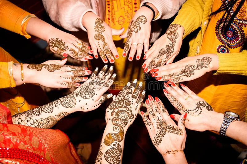 Mehendi Rasm. Hands at the time of Mehendi Rasm during Hindu marriage royalty free stock photo