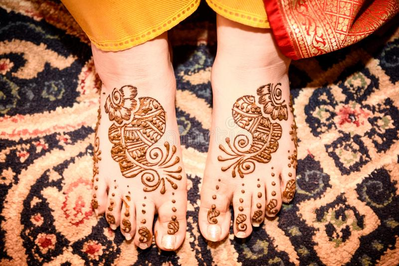 Mehendi Rasm. A woman`s feet with mehendi at the time of mehendi celebration during marriage royalty free stock photo