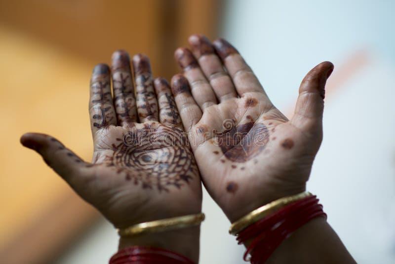 Mehndi design on palms. Dark Mehndi design on human palm royalty free stock images
