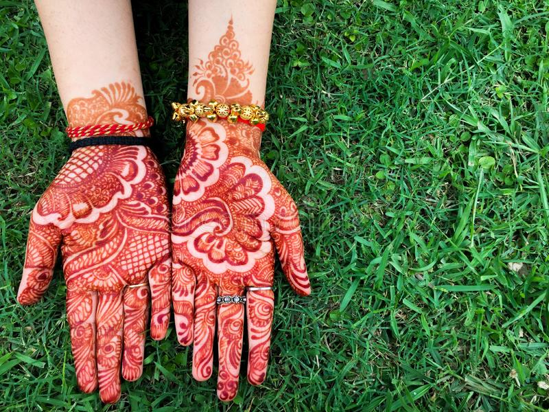 Ornamented Hands. Mehndi is a form of body art originating from the Indian subcontinent, women usually apply Mehendi during fesyive occasions in India royalty free stock photography