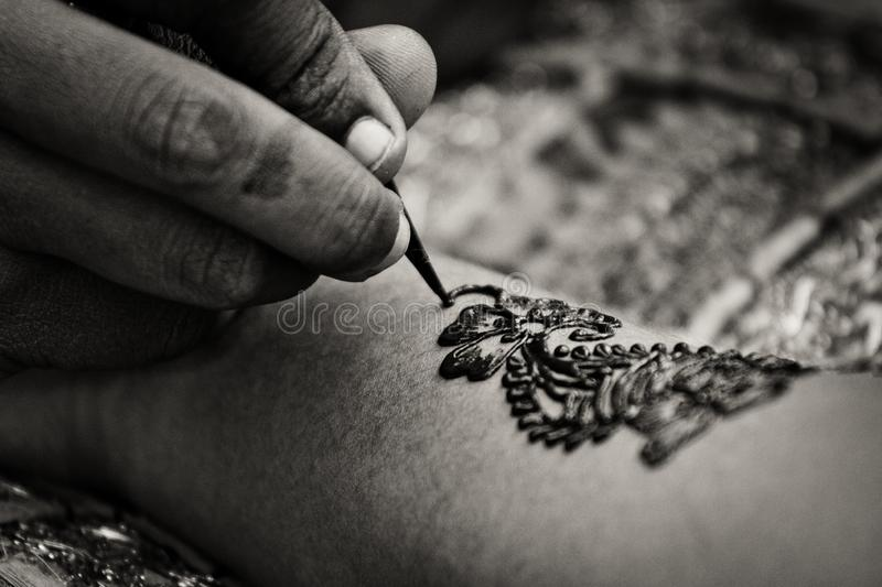 Mehndi. Or mehendi is a form of body art from Ancient India, in which decorative designs are created on a person`s body, using a paste, created from the stock photo