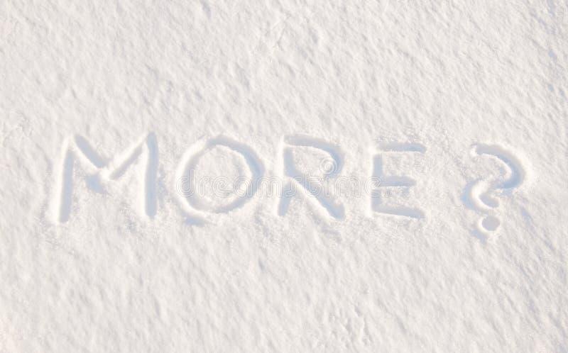 Mehr? - geschrieben in Schnee stockfoto