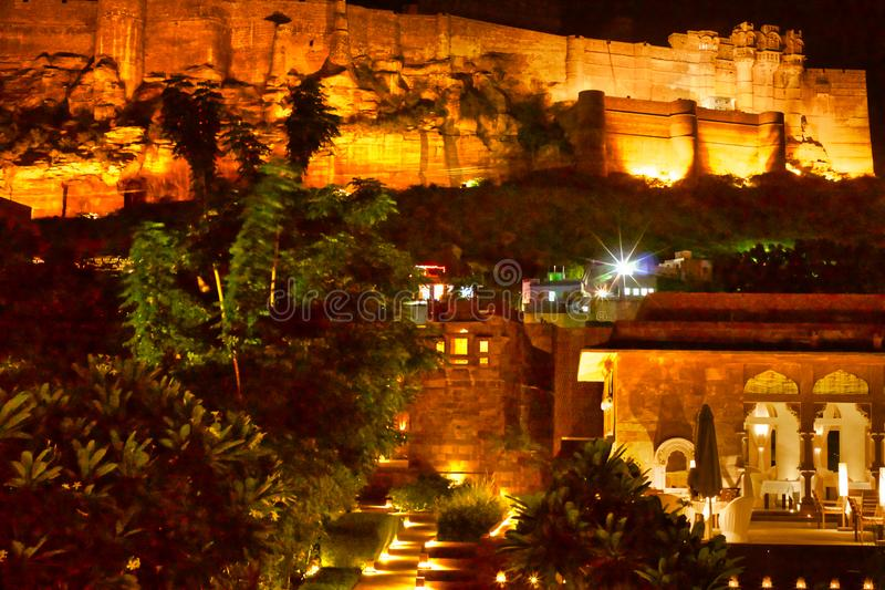 Mehrangarh Fort India. Night time:  A luxury hotel at the foot of the Mehrangarh Fort in Jodhpur in Rajasthan in western India. The fort is situated 125 m above royalty free stock photo