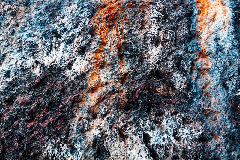 Mehrfarbenschmutzhintergrund mit abstrakten Farben von Rotem, helles Blaues, weiß und ockerhaltig, Granitsteinbeschaffenheit Vers stockfotografie