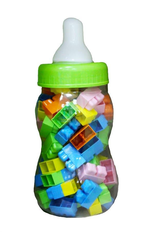 Mehrfarbiger Kind-` s Designer mit Details Spielwaren in der Flasche Getrennt stockfotografie