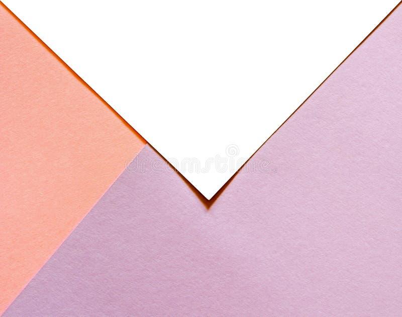 Mehrfarbiger Papierhintergrund mit modischer korallenroter Farbe des Jahres 2019 und ein wei?er lokalisierter Platz f?r Ihren Tex lizenzfreies stockbild