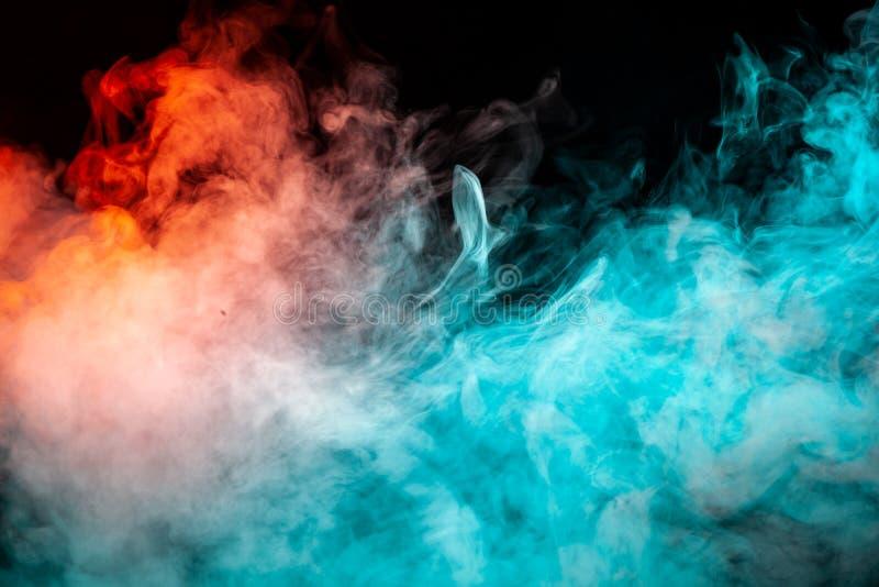 Mehrfarbiges Muster des Rauches der grünen und roten Farben von lizenzfreies stockfoto