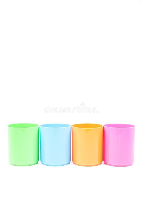 Mehrfarbiges Plastikglas lizenzfreie stockfotos