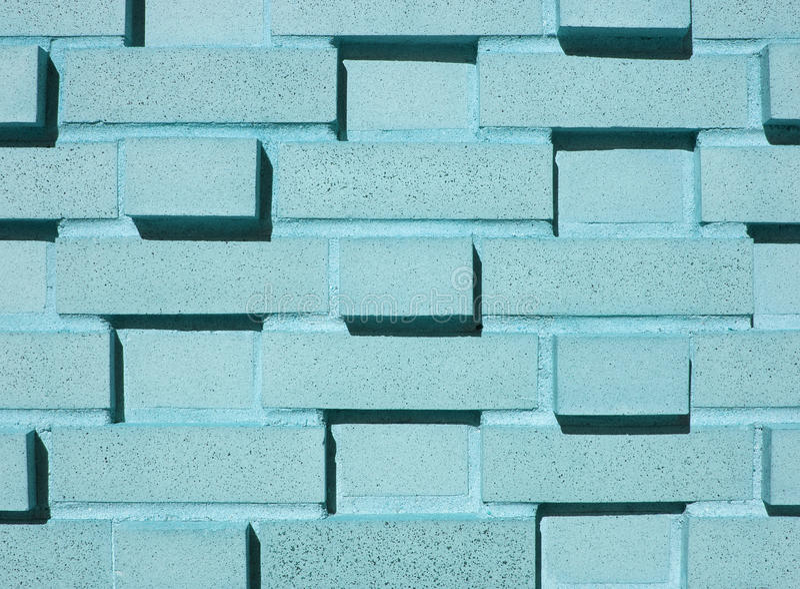 Mehrschichtige Aqua-Backsteinmauer stockfoto