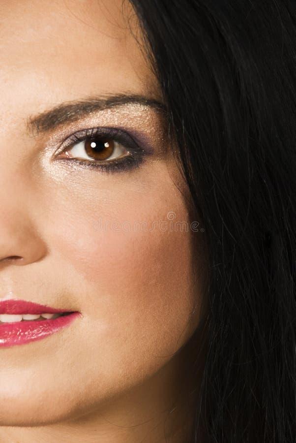 A meia face da mulher da beleza compo fotos de stock royalty free