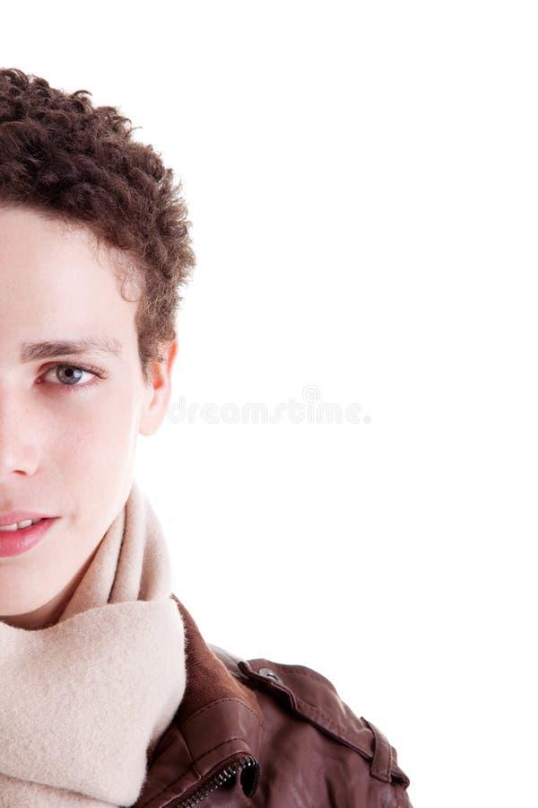 Meia face do retrato de um homem novo considerável foto de stock royalty free