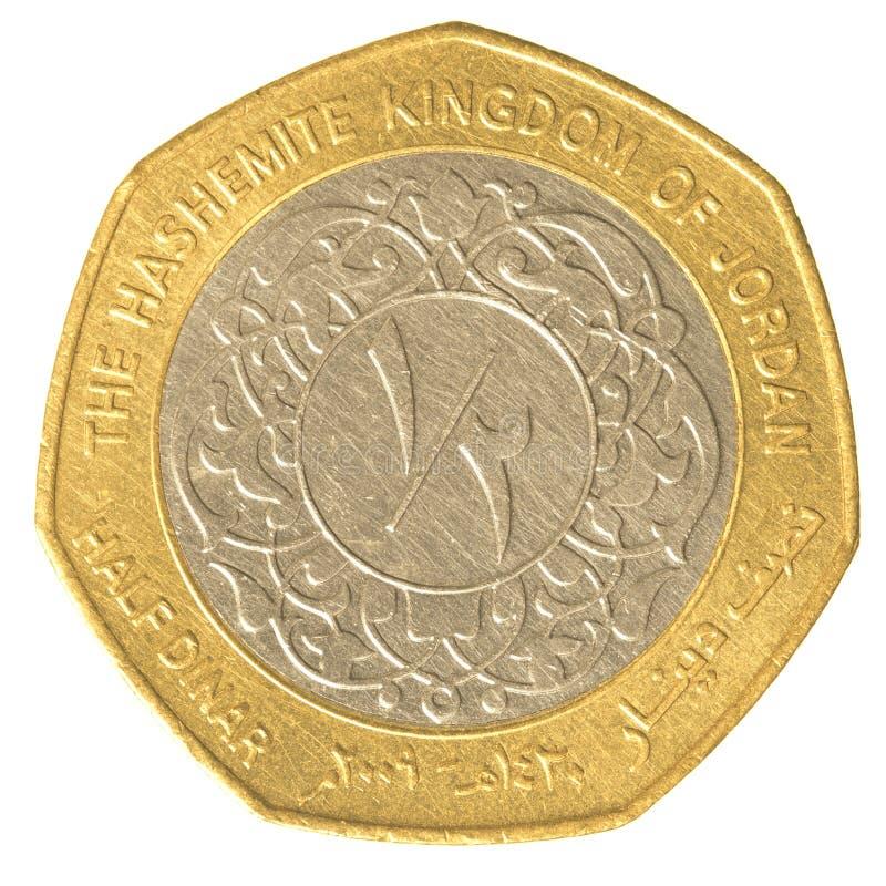 Meia moeda do dinar jordano foto de stock