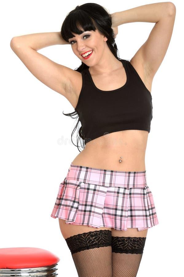 Meias clássicas novas glamoroso 'sexy' atrativas de Pin Up Model In Fishnet e Mini Skirt plissado foto de stock royalty free