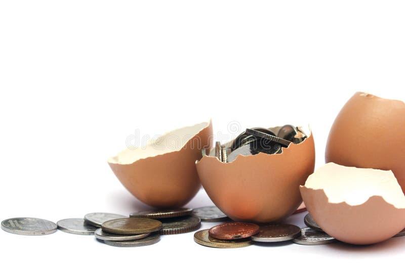 Meio escudo e moeda de ovo, isolados no fundo branco fotografia de stock