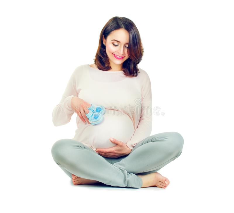 Meio grávido mulher envelhecida que toca em sua barriga Conceito saudável da gravidez imagens de stock royalty free