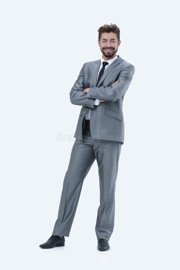 Meio retrato do comprimento de um homem de negócios com mãos em seus bolsos fotos de stock
