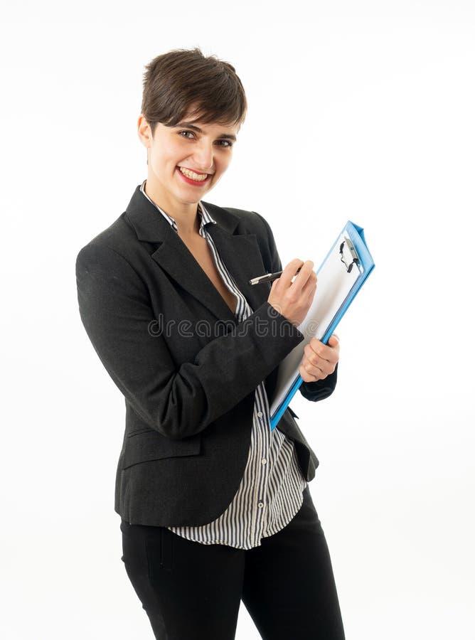 Meio retrato do corpo do comprimento de uma mulher de empresa atrativa que olha feliz e bem sucedida fotografia de stock