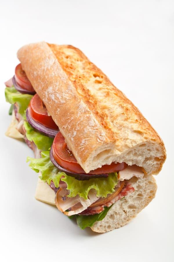 Meio sanduíche das carnes do Baguette fotos de stock
