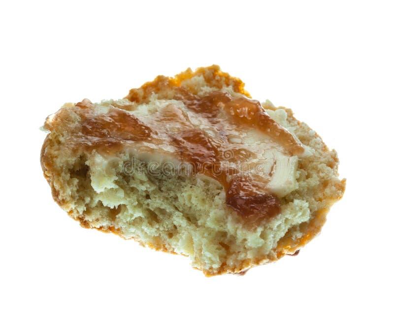 Meio scone com a manteiga e o atolamento isolados imagem de stock royalty free