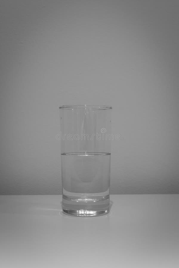 Meio vidro da água foto de stock royalty free