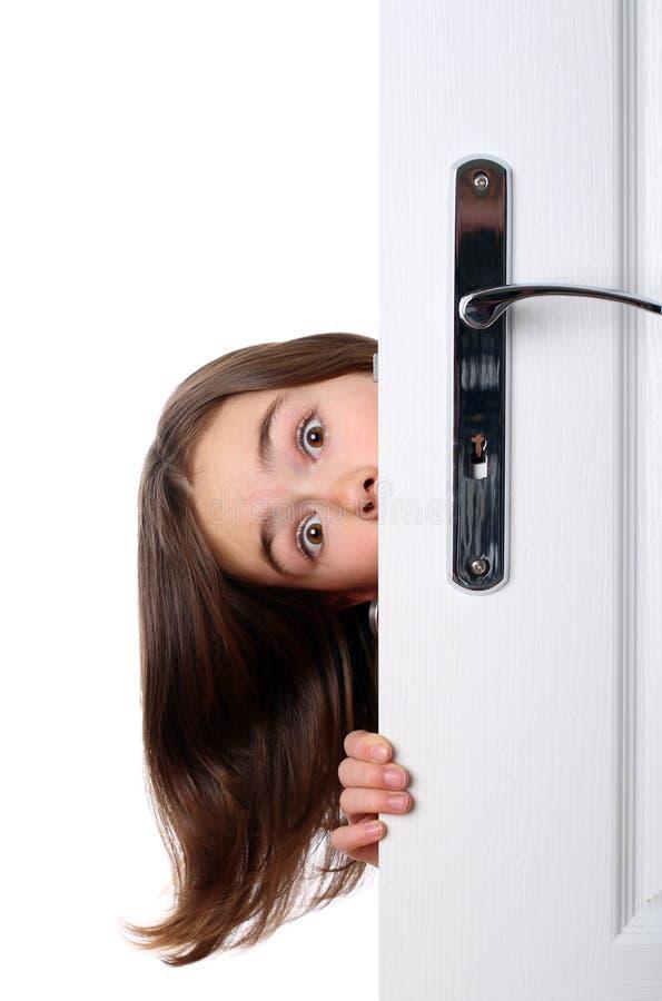 Meisje achter de deur royalty-vrije stock fotografie
