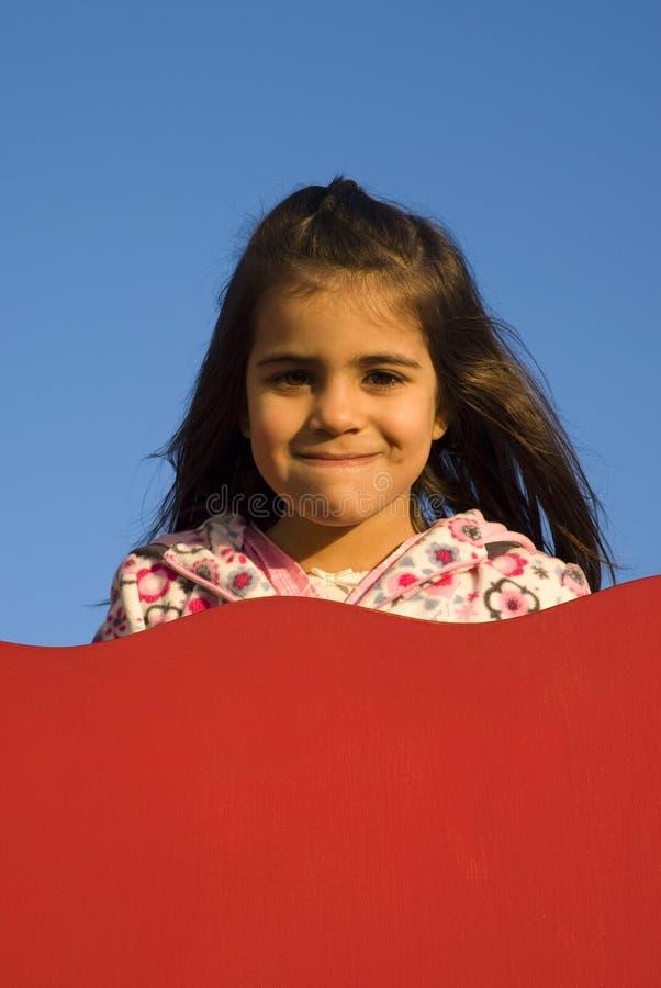 Meisje bij speelplaats royalty-vrije stock afbeeldingen