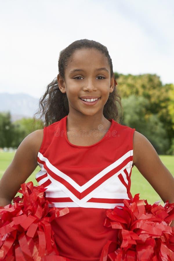 Meisje Cheerleader On Soccer Field royalty-vrije stock afbeelding