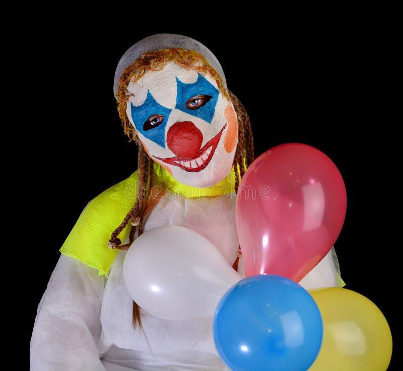 Meisje in clownmasker op zwarte achtergrond royalty-vrije stock fotografie