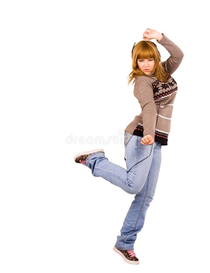 Meisje dat aan het ritme van muziek in hoofdtelefoons danst royalty-vrije stock foto's