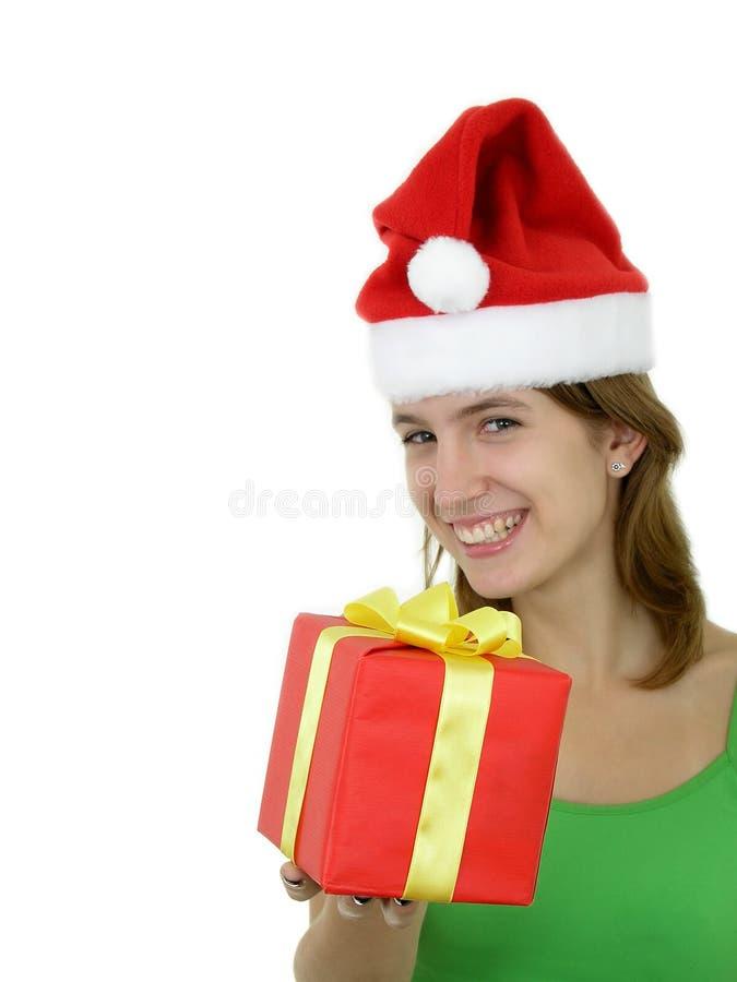 Download Meisje Dat Aanwezige Kerstmis Aanbiedt Stock Afbeelding - Afbeelding bestaande uit groeten, holding: 293227