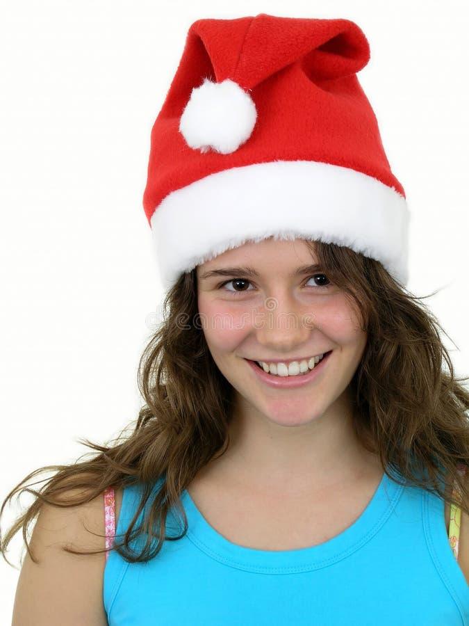 Meisje dat de hoed van Kerstmis draagt stock afbeelding