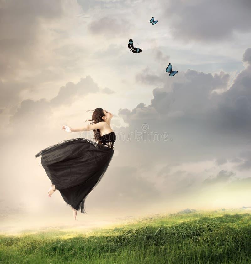 Meisje dat in de Lucht springt royalty-vrije stock afbeeldingen