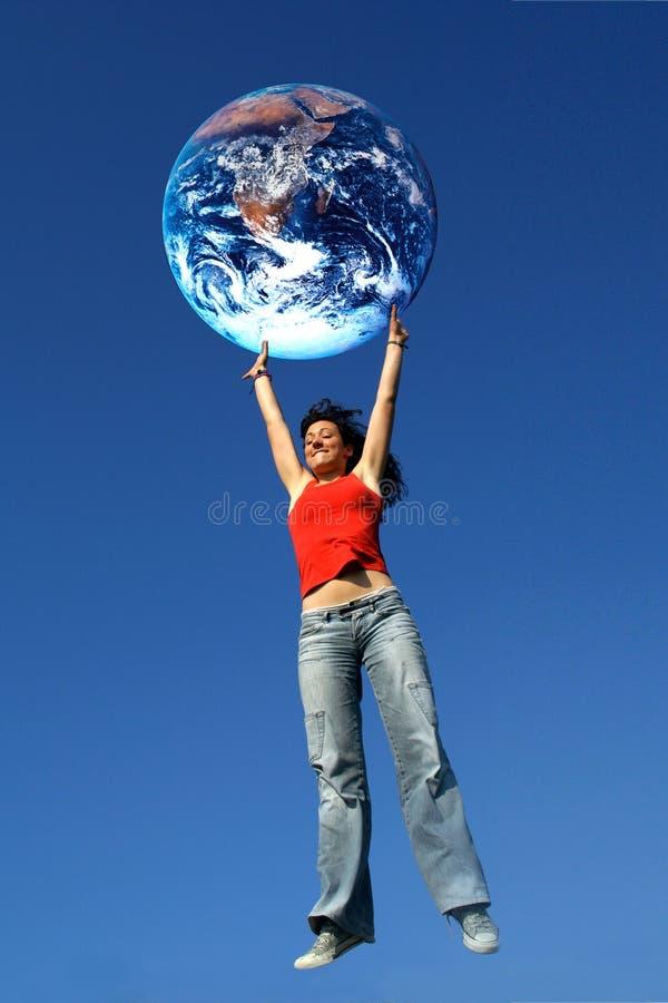 Meisje dat de Wereld houdt stock afbeelding