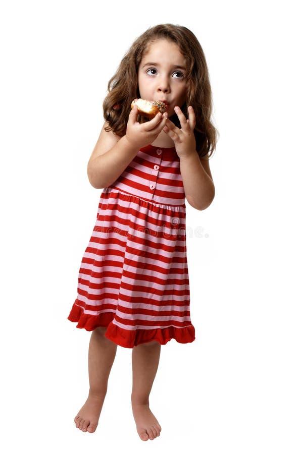 Meisje dat doughnut eet royalty-vrije stock fotografie