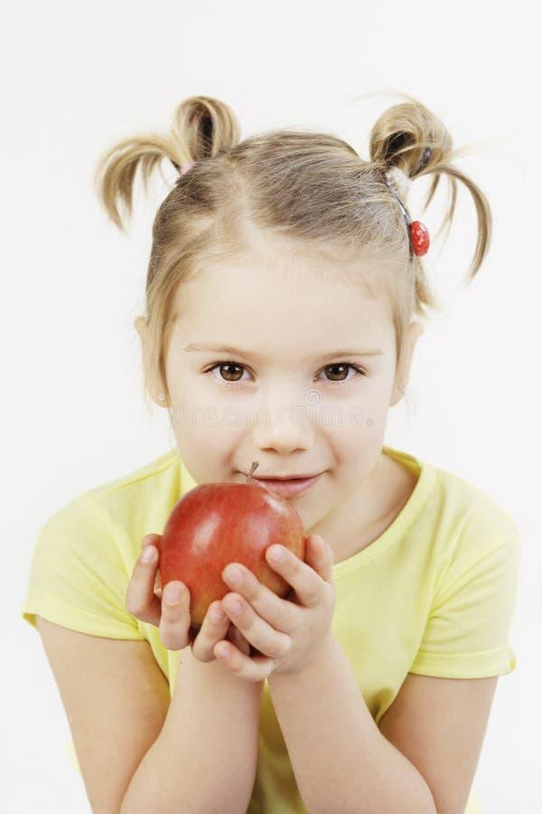 Meisje dat een appel houdt stock fotografie