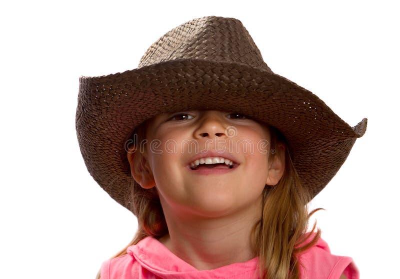 Meisje dat een bruine strohoed draagt royalty-vrije stock foto