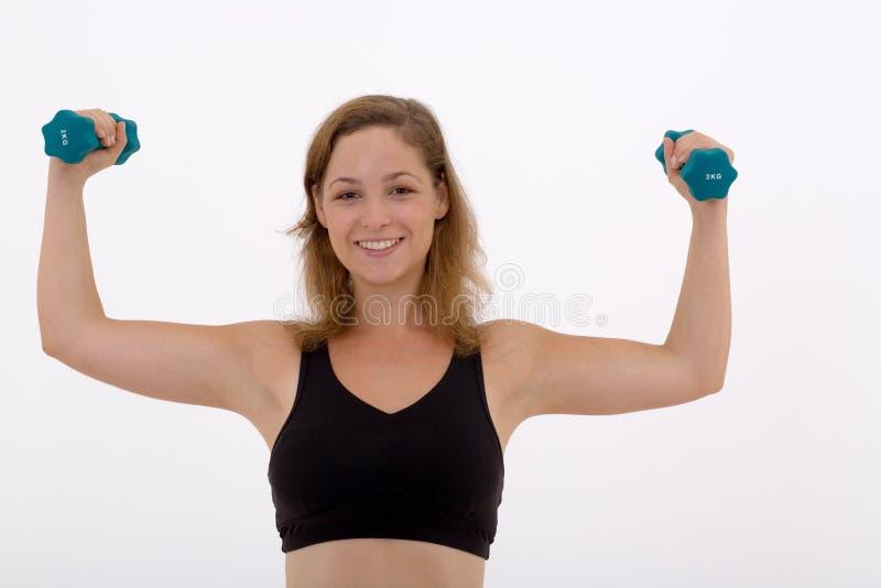 Meisje dat een gewicht opheft royalty-vrije stock afbeelding