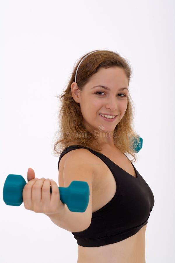 Meisje dat een gewicht opheft stock afbeelding