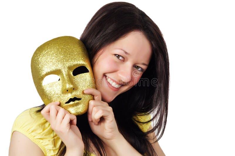 Meisje dat een gouden masker houdt royalty-vrije stock fotografie