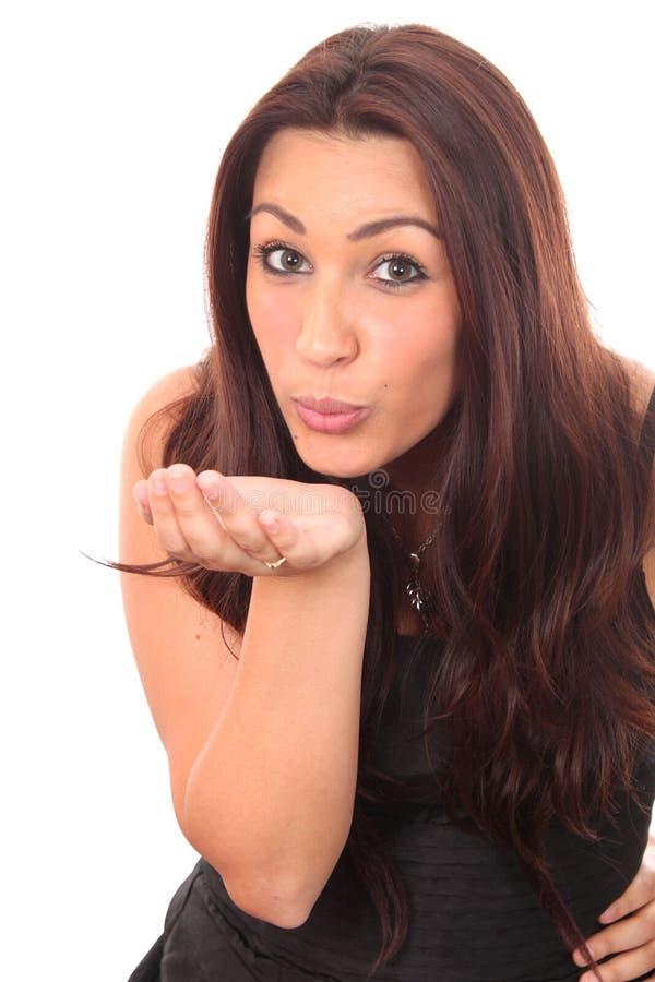 Meisje dat een kus blaast stock foto