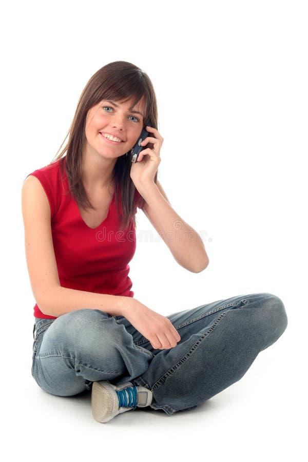 Meisje dat een mobiele telefoon met behulp van royalty-vrije stock afbeeldingen