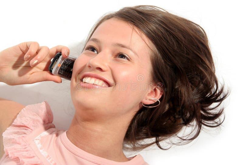 Meisje dat een mobiele telefoon met behulp van royalty-vrije stock foto's